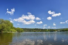 Pond with forest and blue sky with clouds. Brno Dam recreation spot Czech Republic. Czech Republic, City of Brno - Bystrc - Kninic Stock Photos