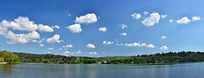 Pond with forest and blue sky with clouds. Brno Dam recreation spot Czech Republic. Czech Republic, City of Brno - Bystrc - Kninic Stock Image