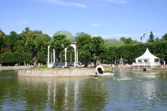 Pond, fountain and arbor Stock Image