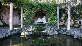 Pond and fountain in the labyrinth of Horta. Barcelona Stock Image