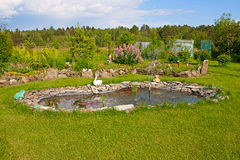Pond in the garden Royalty Free Stock Photography