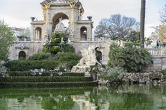 Pond, Golden horses and gargoyles in the Citadel Park in Barcelo Stock Images