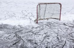 Pond Hockey Net and Snow. A ice hockey net on an outdoor pond rink Royalty Free Stock Images