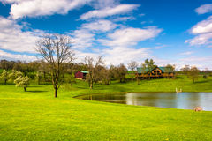 Pond and house in rural York County, Pennsylvania. Royalty Free Stock Images