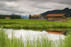Pond with huts Stock Image