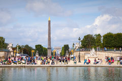 Pond in Jardin des Tuileries with walking tourists Royalty Free Stock Photography