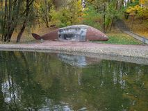 Pond or lake at park in autumn. Place for fishing stock images