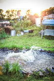 Pond in landscape design with swing and grass Stock Images