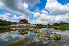 Pond mirror reflection of summer clouds and the pavilion at Royal Park Rajapruek in Chiang Mai, Thailand Stock Image