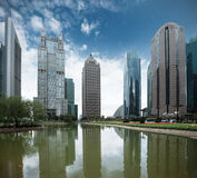 Pond and modern building in shanghai Stock Images