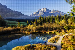 Pond in mountain valley Royalty Free Stock Photos