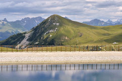 Pond and mountains at La Plagne in France Stock Image