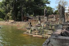 Pond near the temple in the middle of the jungle, Cambodia. Pond near the ruins of the ancient temple of the temple in the middle of the jungle. Complex Angkor Royalty Free Stock Photos