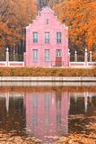 Pond and an old Dutch house in the autumn landscape in Moscow, Kuskovo, Russian Federation royalty free stock photography