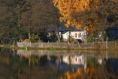 Pond and an old house Royalty Free Stock Images