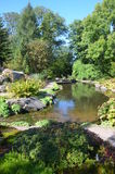 Pond. An ornamental pond among botanical displays in a garden in Gothenburg Royalty Free Stock Photography