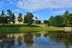 The pond and palace in Gatchina garden. Stock Photo