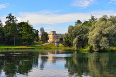 The pond and palace in Gatchina garden. Royalty Free Stock Image