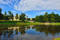 The pond and palace in Gatchina garden. Stock Image