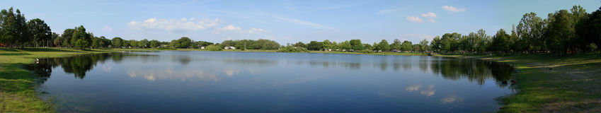 Pond panorama, florida. Panoramic view of a calm pond with a clear reflection. Taken in Clearwater, Florida royalty free stock photo