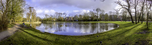 Pond panoramic landscape photo in Vondelpark, Amsterdam. Is a pu royalty free stock photo