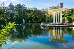 The pond in the Park-the arboretum of Sochi. The pond in the lower Park-the arboretum of Sochi. On the shore is a gazebo with tall white columns Royalty Free Stock Image