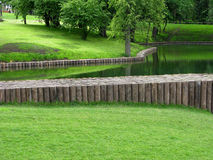 Pond in park with water dam Stock Photo