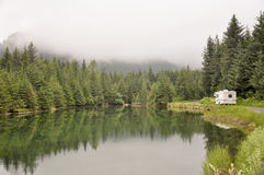 Pond with passing motor home Royalty Free Stock Photography