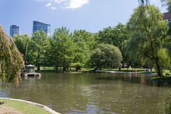 Pond in the Public Garden and buildings in Boston. Massachusetts, USA Royalty Free Stock Images