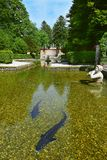 Pond in Public Gardens of Hellbrunn Palace in Salzburg. Salzburg, Austria - May 25, 2019 : sculptures at the pond in Public Gardens of Hellbrunn Palace Schloss stock images