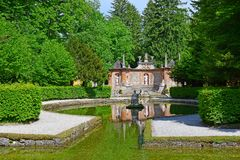 Pond in Public Gardens of Hellbrunn Palace in Salzburg. Salzburg, Austria - May 25, 2019 : sculptures at the pond in Public Gardens of Hellbrunn Palace Schloss stock photo
