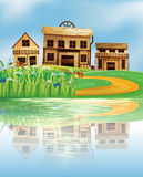 A pond with a reflection of the wooden houses Stock Photos