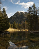Pond Reflections. High mountain landscape with a crystal clear pond on the foreground Royalty Free Stock Image