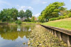 Pond in residential area with water shortage stock photography
