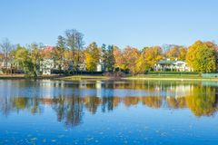Pond in Riga, district agenskalsns. Autumn, yellow tree leaves, Royalty Free Stock Photo