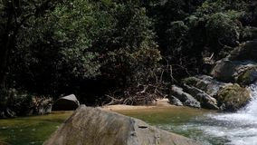 Pond and rocks in big forest at Ton Tok waterfall in Thailand stock footage