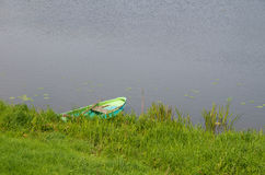 Pond with rowing boat Royalty Free Stock Images