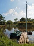 Pond with small dock Stock Photography