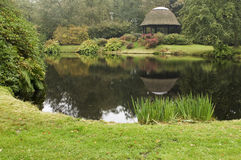 Pond with small house Stock Image