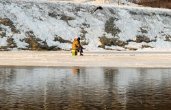 Pond in the spring begins to melt and all fisherman catches a fish. Moscow Russia 2016 March 10 stock photo