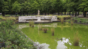 A pond with a statue in the garden of the Tuilerie Royalty Free Stock Images