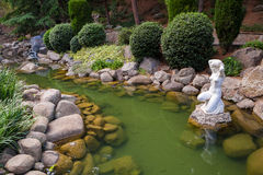 Pond with a statue in south garden Royalty Free Stock Photos