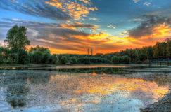 Pond at sunset Stock Images