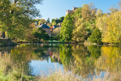 Pond surrounded the trees and meadows. Wales Castle with the Pond surrounded trees and meadows Royalty Free Stock Images