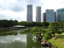 Pond in a traditional Japanese Tokyo garden. Shioiri Pond in Hamarikyu Gardens, Tokyo, Japan Royalty Free Stock Images