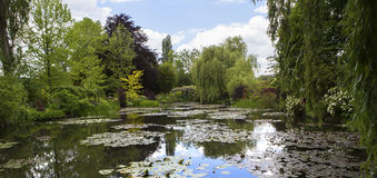 Pond, trees, and waterlilies in a french garden Stock Photos