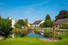 Pond in village of Askeby on Moen in Denmark. On a summer day Stock Photos