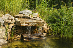 Pond with waterfall. Natural stone pond with waterfall and biological cleaning system Royalty Free Stock Image