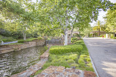 Pond with waterfall at the entrance of gated community in San Diego county. Outdoors in Southern California homes ready for real estate listings Stock Photography