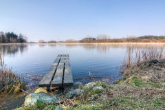 Pond with wooden pier Royalty Free Stock Images